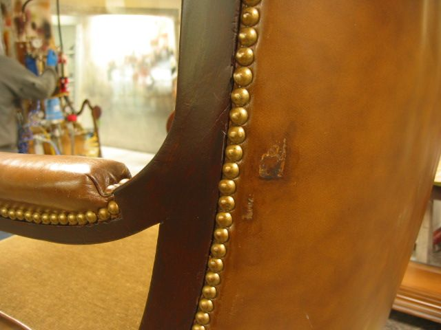 Damaged leather on chair back