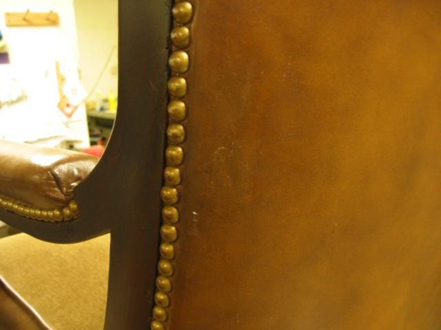 Damage on leather chair back  touched up